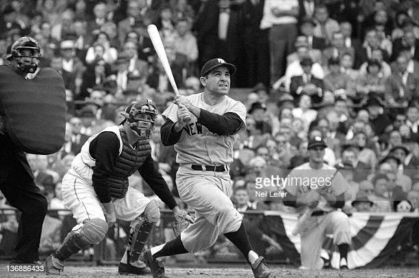 Baseball World Series New York Yankees Yogi Berra in action hitting 3run home run vs Pittsburgh Pirates Smoky Burgess during 6th inning at Forbes...