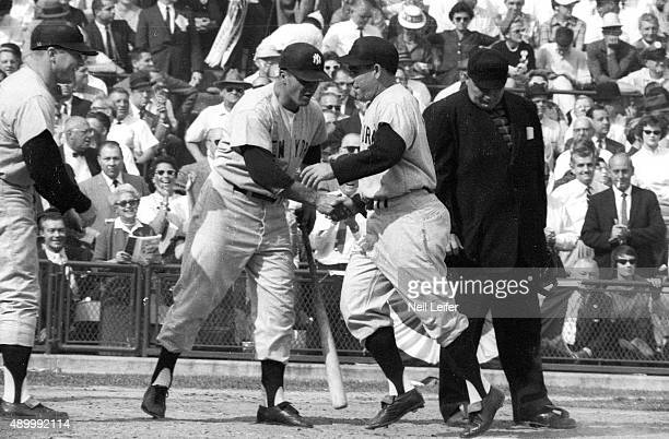 World Series New York Yankees Yogi Berra victorious after hitting home run with Moose Skowron vs Pittsburgh Pirates at Forbes Field Game 7 Pittsburgh...