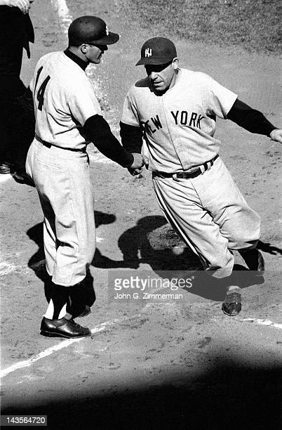 World Series New York Yankees Yogi Berra victorious with Bill Skowron after scoring run vs Brooklyn Dodgers at Ebbets Field Game 7 Sequence Brooklyn...