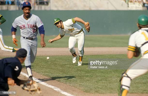 World Series Oakland Athletics Sal Bando in action fielding vs New York Mets Cleon Jones at OaklandAlameda County Coliseum Game 2 Jones scores on...