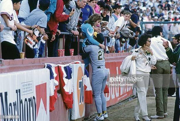 World Series Oakland Athletics Stan Javier helping his wife Veva out of the stands after Loma Prieta earthquake before Game 3 vs San Francisco Giants...