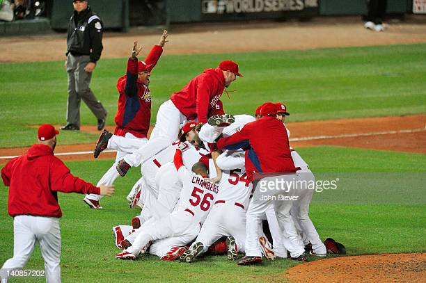 World Series Overall view of St Louis Cardinals players victorious during pileup on field after winning Game 7 and championship series vs Texas...