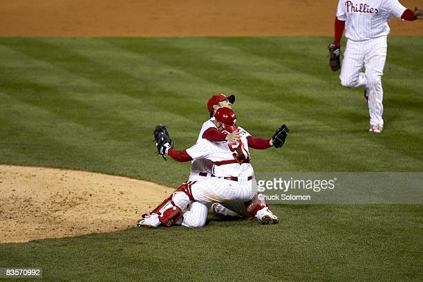 World Series Philadelphia Phillies Brad Lidge and Carlos Ruiz victorious after winning game and series with final strikeout vs Tampa Bay Rays Game 5...