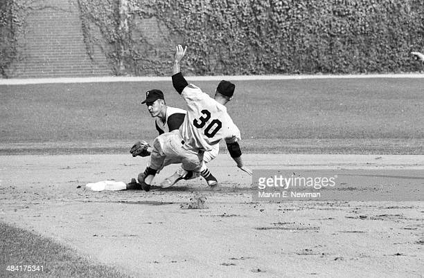 World Series Pittsburgh Pirates Bill Mazeroski in action making double play attempt vs New York Yankees Bobby Shantz at Forbes Field Game 7...