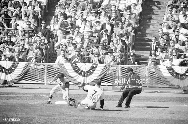 World Series Pittsburgh Pirates Don Hoak in action making 3rd base tag vs New York Yankees Mickey Mantle at Yankee Stadium Game 3 Bronx NY CREDIT...