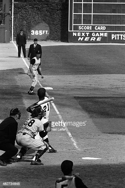 World Series Pittsburgh Pirates Roberto Clemente in action at bat as teammate Bill Virdon takes lead vs New York Yankees during 8th inning at Forbes...