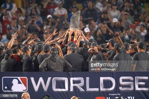 World Series Rear view of Boston Red Sox players victorious with Commissioner's Trophy after winning game and series vs Los Angeles Dodgers at Dodger...