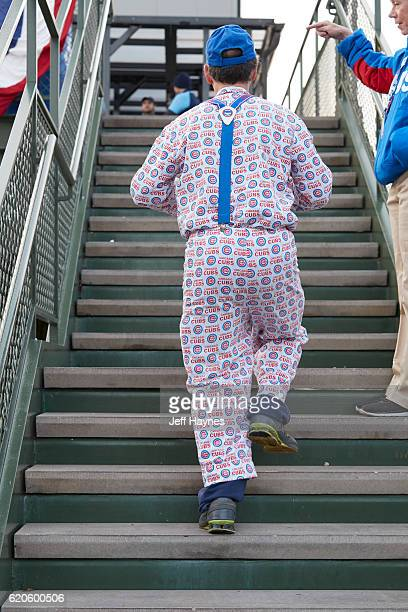 World Series Rear view of Chicago Cubs fan walking up stairs wearing shirt and pants covered in Cubs logo during game vs Cleveland Indians at Wrigley...