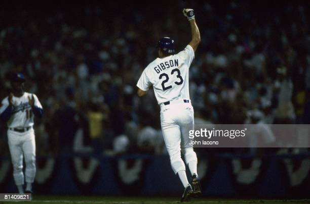 Baseball World Series Rear view of Los Angeles Dodgers Kirk Gibson victorious after hitting game winning walk off home run vs Oakland Athletics Game...