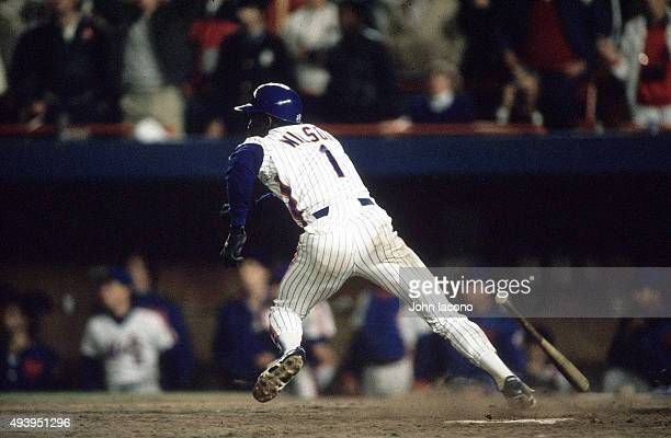 World Series Rear view of New York Mets Mookie Wilson in action running towards first base vs Boston Red Sox at Shea Stadium Game 6 Wilson's grounder...