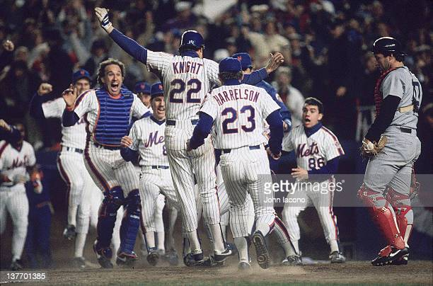 World Series Rear view of New York Mets Ray Knight victorious with teammates at home plate after scoring game winning run vs Boston Red Sox at Shea...