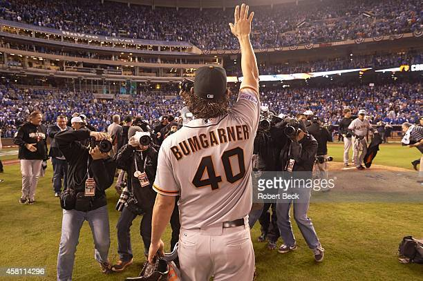 World Series Rear view of San Francisco Giants Madison Bumgarner victorious after winning game and series vs Kansas City Royals at Kauffman Stadium...