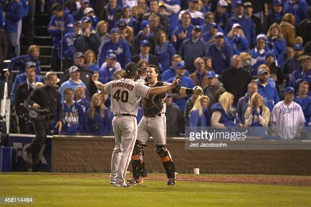 World Series Rear view of San Francisco Giants Madison Bumgarner victorious with Buster Posey after winning game and series vs Kansas City Royals at...