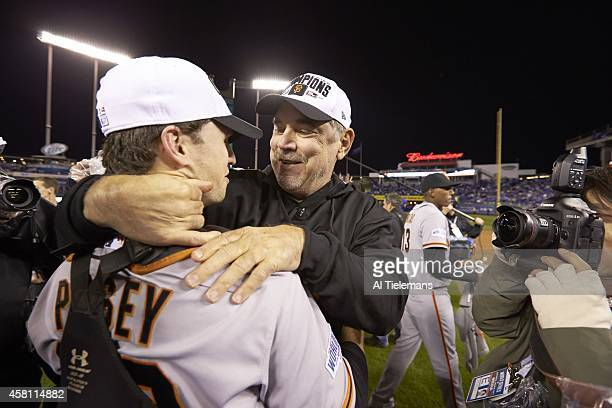 World Series San Francisco Giants Buster Posey victorious hugging manager Bruce Bochy after winning Game 7 and championship series vs Kansas City...