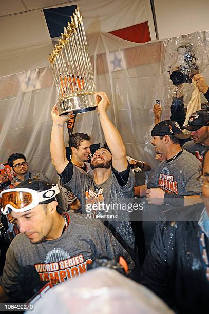 World Series San Francisco Giants Cody Ross victorious with Commissioner's Trophy while during locker room celebration after winning Game 5 and...