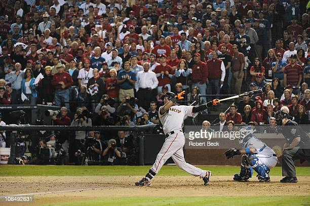 World Series San Francisco Giants Edgar Renteria in action hitting threerun home run vs Texas Rangers during seventh inning Game 5 Arlington TX...