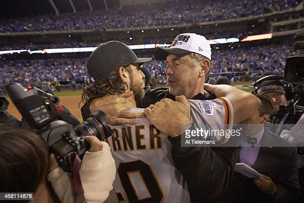 World Series San Francisco Giants Madison Bumgarner victorious hugging manager Bruce Bochy after winning Game 7 and championship series vs Kansas...