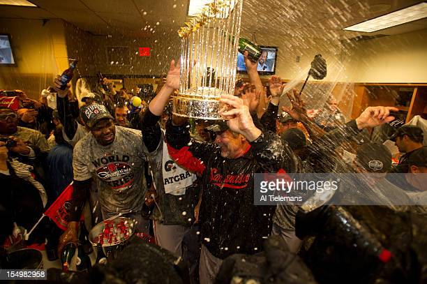World Series San Francisco Giants manager Bruce Bochy victorious holding Commissioner's Trophy in locker room after winning Game 4 and championship...