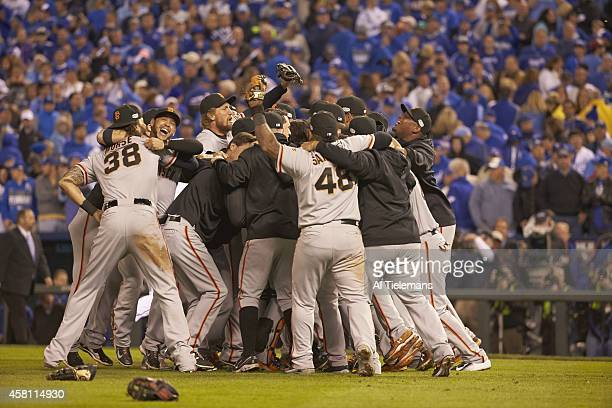 World Series San Francisco Giants players victorious on field after winning Game 7 and championship series vs Kansas City Royals at Kauffman Stadium...