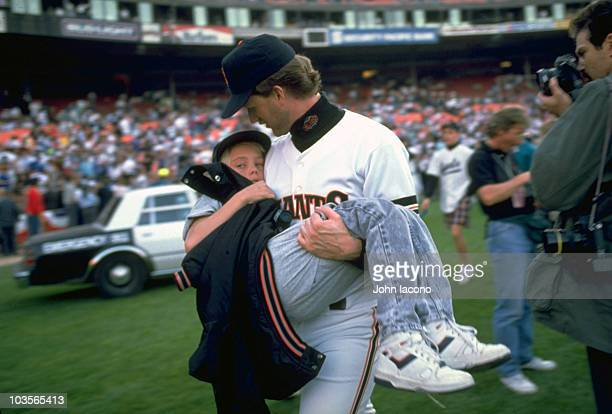 World Series San Franciso Giants Kelly Downs carrying 11yearold nephew Billy Kehl after Loma Prieta earthquake Game 3 vs Oakland Athletics was...