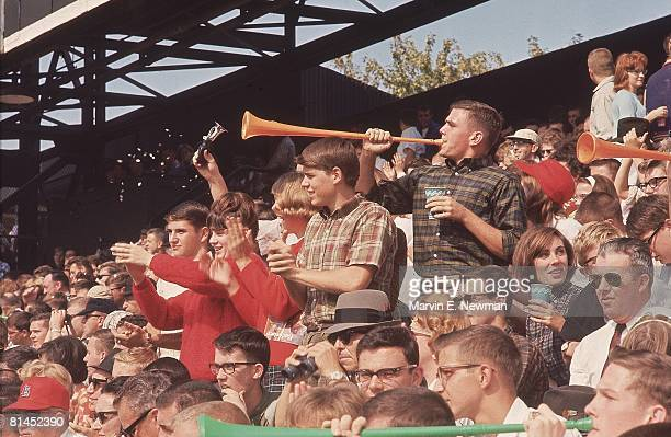 Baseball World Series St Louis Cardinals fans blowing horns during game vs New York Yankees St Louis MO 10/8/1964