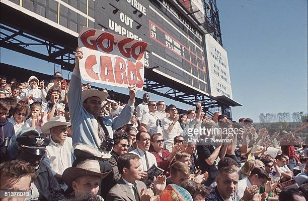 Baseball World Series St Louis Cardinals fans with GO GO CARDS sign during game vs New York Yankees St Louis MO 10/8/1964