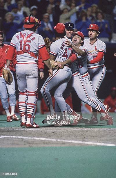Baseball World Series St Louis Cardinals Joaquin Andujar on field and upset arguing with umpire and getting restrained by teammates during game vs...