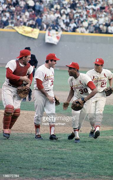 World Series St Louis Cardinals Tim McCarver Nelson Briles Orlando Cepeda and Julian Javier victorious after winning game vs Boston Red Sox at Busch...