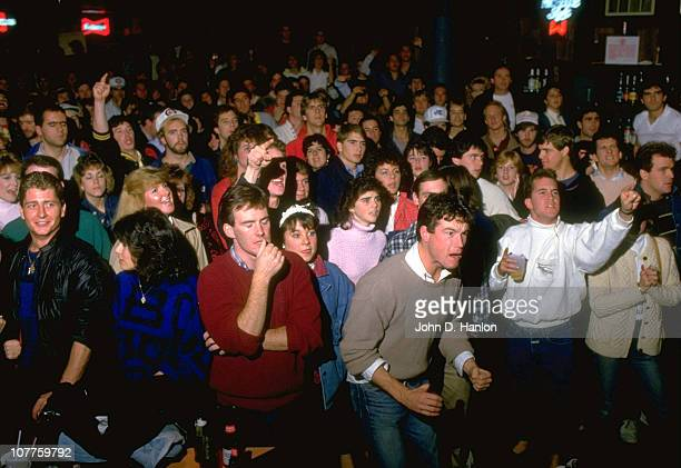World Series View of Boston Red Sox fans watching TV in bar reacting to Bill Buckner missing ground ball hit by NY Mets Mookie Wilson