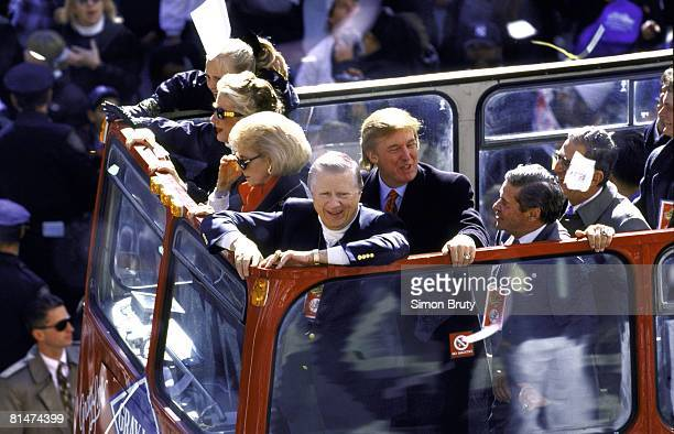 Baseball World Series View of New York Yankees owner George Steinbrenner victorious with wife Joan and celebrity businessman Donald Trump aboard bus...