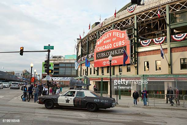 World Series View of old fashioned police car sporting megaphone on roof outside of Wrigley Field before Chicago Cubs vs Cleveland Indians game Game...