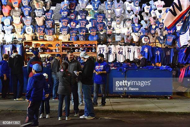 Worlds Series View of fans gathered in front of vendor selling team merchandise before Chicago Cubs vs Cleveland Indians Game 3 during photo shoot in...