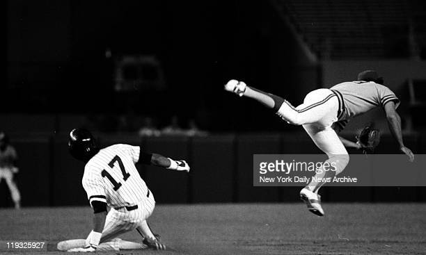 Baseball Yankees vs Oakland Yankees' Oscar Gamble slides into second base as Dave McKay of A's chases bad throw on ball hit by Reggie Jackson
