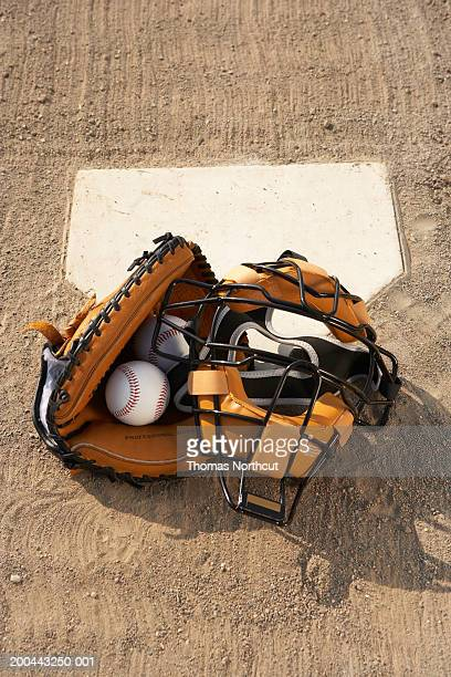 baseballs and catcher's mask and glove at home plate, elevated view - base sports equipment stock pictures, royalty-free photos & images