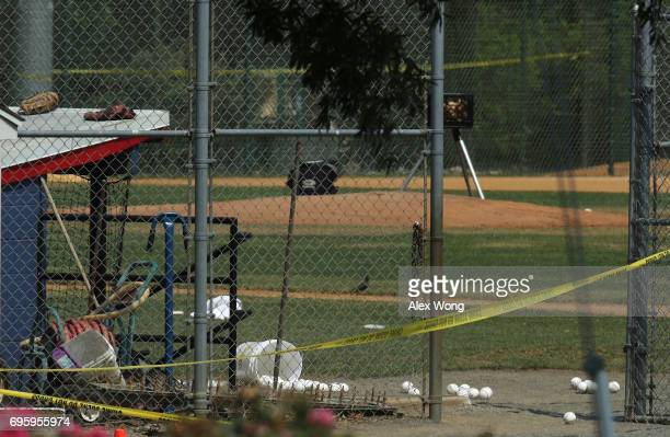 Baseballs are left behind by the dugout area at the Eugene Simpson Stadium Park where a shooting had happened June 14 2017 in Alexandria Virginia US...