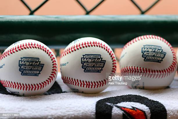 Baseballs are seen in the dugout during the game between the New England team and the MidAtlantic team at Lamade Stadium during the Little League...