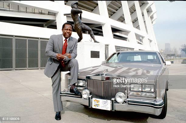 MLB Baseball's Hammering Hank Aaron poses with his signature Cadillac by Robinson Cadillac At Fulton County Stadium in Atlanta Georgia on June 7 1983