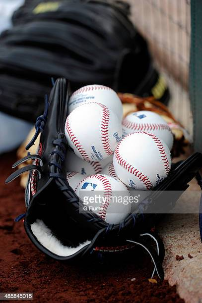 Baseballs in a glove on the field before the game between the Washington Nationals and the St Louis Cardinals at Nationals Park on April 18 2014 in...