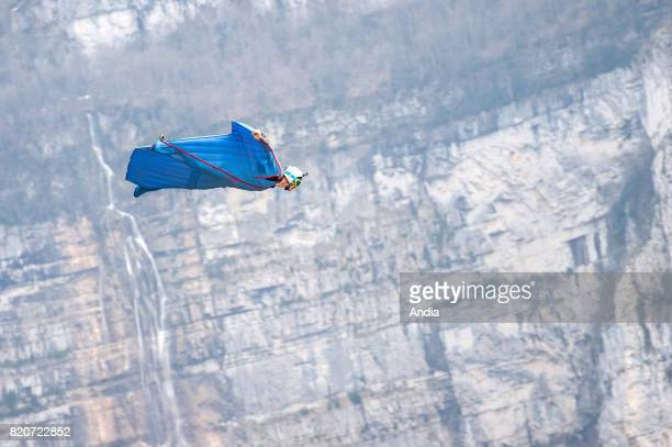 paraglider jumping from the Choranche cliffs Basejumper in flight wearing a wingsuit