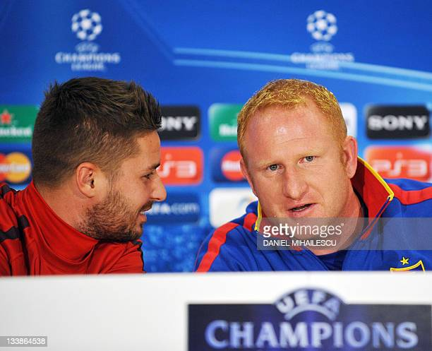 FC Basel coach Heiko Vogel chats with player Markus Steinhofer during a press conference at The National Arena Stadium prior to the official training...