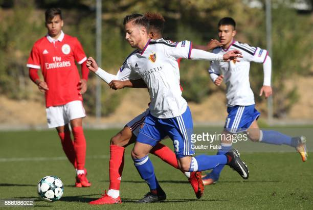 Basel defender Dejan Zunic from Switzerland with SL Benfica midfielder Gedson Fernandes from Portugal in action during the UEFA Youth League match...