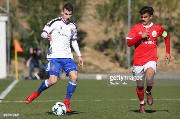 Basel defender Mattia Celant from Switzerland with SL Benfica forward Joao Filipe from Portugal in action during the UEFA Youth League match between...