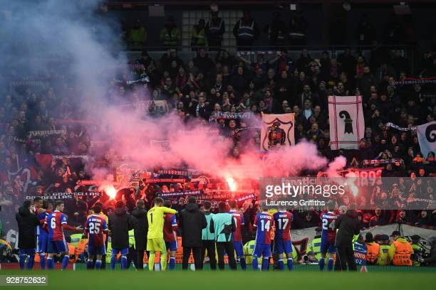 Basel fan celebrate their teams victory following the UEFA Champions League Round of 16 Second Leg match between Manchester City and FC Basel at...