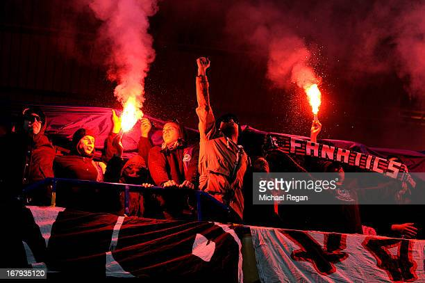 Basel fans cheer on their team whilst lighting flares during UEFA Europa League semi final second leg match between Chelsea and FC Basel 1893 at...