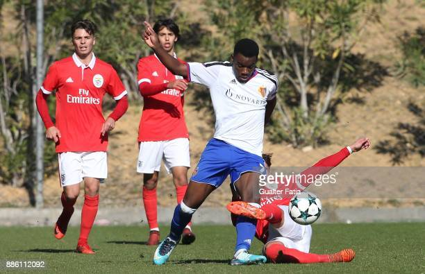 Basel forward Afimico Pululu from France with SL Benfica defender Ricardo Araujo from Portugal in action during the UEFA Youth League match between...
