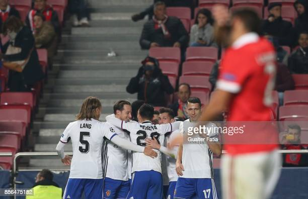 Basel forward Dimitri Oberlin from Switzerland celebrates with teammates after scoring a goal during the UEFA Champions League match between SL...