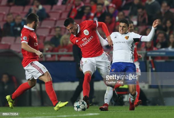 Basel forward Moha Elyounoussi from Norway with SL Benfica midfielder Andreas Samaris from Greece in action during the UEFA Champions League match...