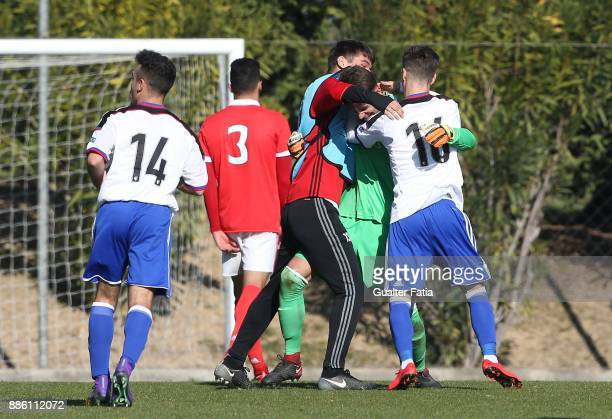 Basel goalkeeper Jozef Pukaj from Switzerland celebrates the draw with teammates at the end of the UEFA Youth League match between SL Benfica and FC...