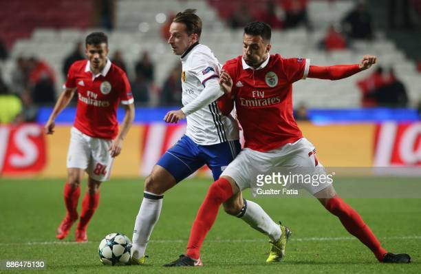 Basel midfielder Luca Zuffi from Switzerland with SL Benfica midfielder Andreas Samaris from Greece in action during the UEFA Champions League match...