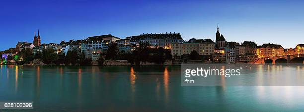 Basel panorama skyline with Rhine river at blue hour - capital city in Switzerland
